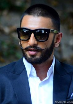 Attitude! One of the sexiest pictures of Ranveer Singh till date - all suited up while flaunting his handlebar moustache, beard and black sunglasses. via Voompla.com