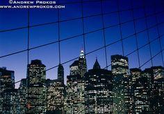 Lower Manhattan Skyline through Brooklyn Bridge Suspension Cables at Night - http://andrewprokos.com
