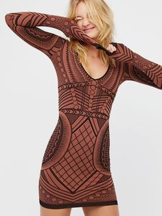 Not An Illusion Bodycon | American made geo printed long sleeve bodycon mini with a plunging V-neckline and ribbed trims. Features a stretchy, seamless fit.