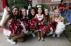 Solvei Modkins, 3 from Dallas, poses with OU Pom Pon squad members Brigette, Chrissy, Alicia, Molly and Katie in front of the Student Union before the college football game between the University of Oklahoma Sooners (OU) and the Tulsa University Hurricanes (TU) at the Gaylord Family-Memorial Stadium on Saturday, Sept. 3, 2011, in Norman, Okla. Photo by Steve Sisney, The Oklahoman