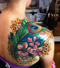 Flower And Peacock Tattoo On Back Shoulder...IMO: too many elements, but the color saturation is great, especially the watercolor affect on the feather