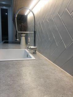 Abey schock Quattro with herringbone tile backsplash