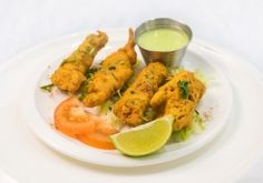 Deep fried snack made of chicken dipped in a batter of gram flour. Crispy slices served with chutney. Chicken Dips, Butter Chicken, Chicken Pakora, Gram Flour, Stavanger, Lassi, Chicken Nuggets, Biryani, Naan