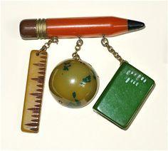 pencil, ruler, globe, & book pin
