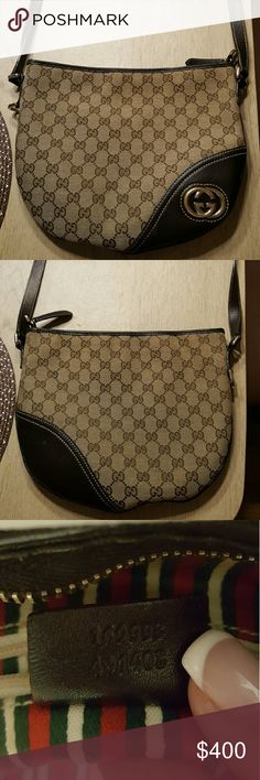 Gucci Crossbody purse Authentic crossbody purse in excellent condition.  Small stain on the inside shown in picture. Gucci Bags Crossbody Bags