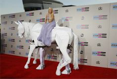 THE American Music Awards or the AMAs served up the weekend's most talked-about pictures; Lady Gaga rode in on a white horse, operated by two humans who dressed up as its legs, while Rihanna collected the Icon Award from her mother, Monica Braithwaite. American Music Awards, Justin Timberlake, Celebrity Look, Celebrity Photos, Jennifer Lopez, Rihanna, Lady Gaga Outfits, Horse Fashion, Awesome