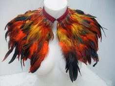 orange-red-black rooster feathers shall with red hot small feathers at the neck collar..Shoulders Feathers fire bird phoenix cape.