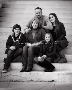 family pose on stairs. something like this will be happening.