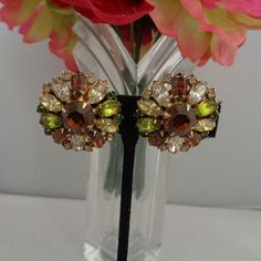 Hobe Vintage Rhinestone Earrings featuring Greens and Brown Colors Set in Goldtone and Signed. Free Shipping to the United States. Price is $39.99.
