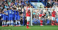 Arsenal players look dejected as Chelsea celebrate their 6-0 victory in March of this year...