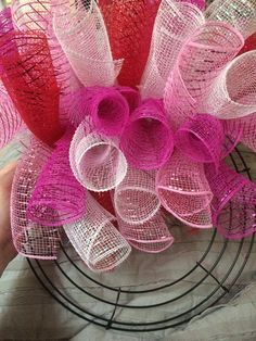Step-by-step instructions to make a curly Deco-Mesh wreath Red white and pink works for Valentine s Day but mix it up for other holidays and seasons Fall Mesh Wreaths, Mesh Ribbon Wreaths, Christmas Mesh Wreaths, Valentine Day Wreaths, Deco Mesh Wreaths, Easter Wreaths, Valentines, Mesh Bows, Deco Mesh Ribbon