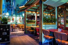 Levi's Caribbean Smokehouse Opens with retro-vibe interiors by Designers Caribbean Cafe, Caribbean Restaurant, Caribbean Decor, Smoke Restaurant, Jamaican Restaurant, Restaurant Bar, Restaurant Branding, Restaurant Interior Design, Cafe Interior