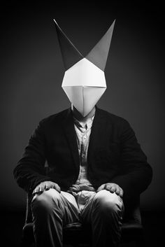 """Designer Francesca Lombardi has created a menagerie of haunting origami animal masks, which have been photographed in beautiful black and white portraits by fashion photographer Giacomo Favilla for a series called """"One of Us. Animal Masks, Animal Heads, Rabbit Origami, Paper Mask, Origami Animals, Origami Design, Illustration, Magritte, Halloween Disfraces"""