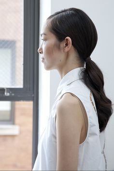 Buns and ponytails are worn low (SS15, Jason Wu)