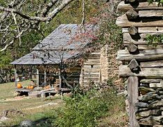 Old log cabin, with an old barn in the Appalachian Mountain's