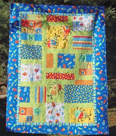 """Beetle Boy"" Baby Quilt. 50""x40"" Machine pieced, machine applique; heavy free motion quilting.. QUILTS BY MARISELA."