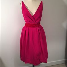 Narciso Rodriguez cocktail dress Absolutely Eye Catching stunning pink cocktail dress with red velvet tie at waist.  This dress was originally $3000 and is for sale at $800 very great deal.  Created by the famous designer Narciso Rodriguez. This dress is inimmaculate condition.  The dress is a size 4 Narciso Rodriguez Dresses Midi Famous Designer, Pink Cocktail Dress, Narciso Rodriguez, Red Velvet, Wrap Dress, Tie, Formal Dresses, Womens Fashion, Closet