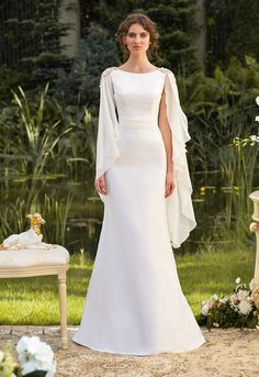 A graceful and a very stylish silhouette dress made from soft taffeta but surprisingly light and comfortable. A thin draped belt accents the waist and chiffon sleeves echo swan's wings. Décor on shoulders in shape of petals covered with crystals and stones couples perfectly with delicate matte fabric and modesty style. The style is made […]