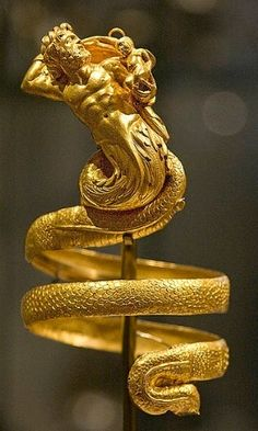 Hellenistic Greek, Gold armband with triton holding Erotes...