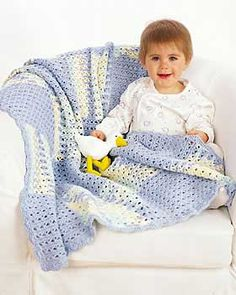 Solid blocks of blue alternate with soft ombre blocks in this interesting crochet baby blanket. Use this baby blanket crochet pattern to create a soft blanket for a new baby boy.