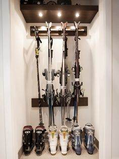 Ski rack: board with non-wood rack attached.