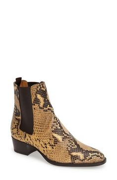 Free shipping and returns on Saint Laurent 'Wyatt' Chelsea Boot (Women) at Nordstrom.com. The mod Chelsea boot meets Western-inspired style on this thoroughly luxe look from Saint Laurent. Crafted from supple, python-embossed leather, this sophisticated boot features a slim silhouette, elongated topline and almond toe.