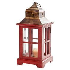"Bring a touch of country-chic style to your eat-in kitchen or formal dining room with this lovely essential, brimming with farmhouse-inspired charm.  Product: Lantern  Construction Material: Wood, metal and glass   Color: Red and gold   Features:     Perfect for indoor or outdoor use  Rope hanger included  Classic silhouette    Accommodates: (1) Candle - not included      Dimensions: 14.5"" H x 6.5"" W x 6.5"" D     Shipping: This item ships small parcelExpected Arrival Date: Between 04/13/2013…"
