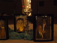 table centerpieces: crystal votive w/tripod (from Hobby Lobby), turquoise fabric, and lighted framed prints