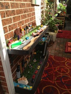 This small outdoor space has several sections with inviting stations for children to explore. A city landscape prop was created in this station for children's pretend play - Puzzles Family Day Care  Environment.  For more inspiring spaces: http://pinterest.com/kinderooacademy/provocations-inspiring-classrooms/ ≈ ≈
