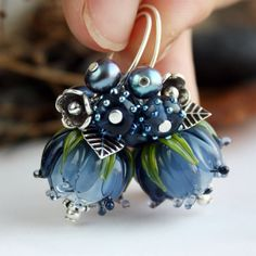 ~ Made To Order ~ This is a elegant lampwork earrings with beautiful dark blue flowers on long ear wire loops. All findings of the earrings are