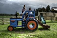 Side profile with kids (Children's blue wooden tractor with slide)