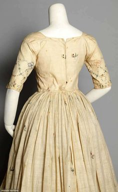 MUSLIN WEDDING GOWN, 1795 Dress w/ matching petticoat, delicate painted border designs & scattered painted sprigs.
