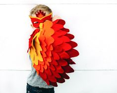 Artículos similares a Childrens Fire bird Costume, Phoenix Costume, Bird Wings and Mask Kids Halloween Dress up Toy, Girls and Boys, Toddlers en Etsy Parrot Costume, Bird Costume, Halloween Dress, Halloween Kids, Phoenix Costume, Bird Masks, Bird Wings, Baby Costumes, Mask For Kids