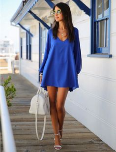 "This crisp Bikini Luxe ""Wanderlust"" Blue Chiffon Dress is the perfect dress for Summer. The loose fit of this chiffon dress makes it ultra comfortable, and the long sleeves are slit down to the wrists, to give you a sophisticated look. The Wanderlust summer dress is light and airy, and is made of silky blue soft fabric. The V-neck front creates the perfect frame for a dainty necklace, or a statement piece. Luxe up your look with a gold chain belt.  #dress #summerdress #chiffondress"