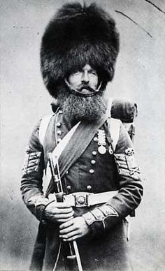 """Sergeant """"Willie"""" McGregor of the Scots Fusilier Guards, photographed in 1856 after the Crimean War, wearing the post-war tunic but with his Crimean beard."""