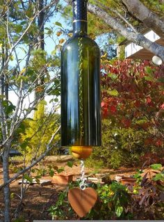 how to make a wine bottle wind chime, how to, Wine Bottle Wind Chime by Groovy Green Glass
