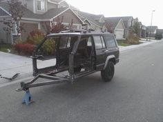 Jeep Cherokee camper trailer from front