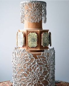 Last year at the 2016 Oklahoma Sugar Arts Show, Ted Scutti debuted a masterful cake inspired by the Mad for Metallic's theme of the show. This stunning design featured ornate silver cages. We share some close-ups of Ted's gorgeous cake. Unique Wedding Cakes, Unique Cakes, Elegant Cakes, Beautiful Wedding Cakes, Gorgeous Cakes, Wedding Cake Designs, Pretty Cakes, Amazing Cakes, Crazy Cakes