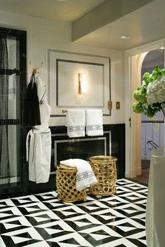 The gold stools are amazing and I love the various designs created with the black and white tile work. Via la dolce vita, Jamie Herlzinger