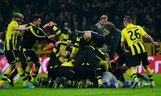 ~ Borussia Dortmund celebrating their win against Malaga CF in the UEFA Champions League. Dortmund scored two goals in extra time to beat Malaga 3-2 ~