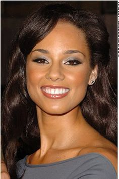 alicia keys. ive been told by 2 strangers on 2 seperate occasions that i look like alicia keys, i see it a little bit, and im SO FLATTERED!! lol shes beautiful!!