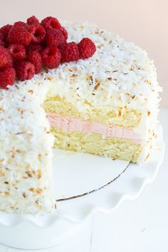 Coconut Cake with Marshmallow Frosting and Raspberry Buttercream Filling