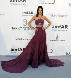 [8:39] Model Kendall Jenner poses during a photocall as she arrives to attend the amfAR's Cinema Against AIDS 2015 event
