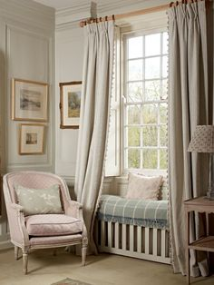 Petite Bergere Library Chair in dusky pink. Apple Blossom Duck Egg Silhouette cushion on the chair. Curtains in Natural Sail Blue Stripe with a Rose Shalini cushion on the window seat.
