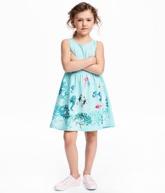 Check this out! Sleeveless dress in soft cotton jersey with a printed pattern. Gathered seam at waist and flared skirt. - Visit hm.com to see more.