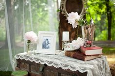 Use an old desk or table for the parents/ grandparents wedding photos or even an old chest with memorabiliia