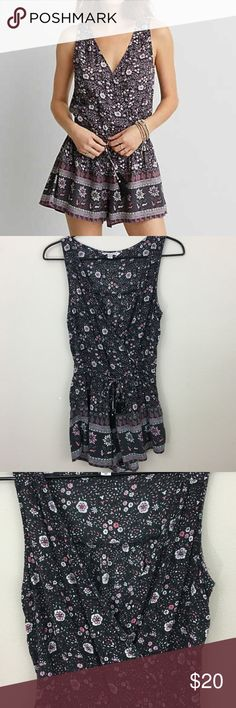 """American Eagle Charcoal Boho Romper Fun floral boho style romper from American Eagle. Flattering charcoal gray with pink flowers. Features surplice top and tasseled drawstring waistband. Size S; Approx measurements - Bust: 18""""  Length: 28.5"""" American Eagle Outfitters Shorts"""