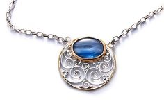 Beautiful pendant made of sterling silver goldplated with a high quality kyanite . Handwork inspired in Artdeco designs using Balinease traditional techniques. By Memento Jewelry
