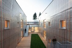 Petr Stolin Architekt has wrapped a double-skinned translucent facade of fibreglass around the Nová Ruda kindergarten in the Czech Republic. Nova, Channel Glass, New Housing Developments, Timber Roof, Metal Cladding, Reinforced Concrete, School Building, Brick Building, Steel Structure