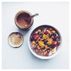 Wild Blueberry And Cardamom Porridge Topped With Banana, Raspberries, Blueberries, Sea Buckthorn Berries, Dried Incaberries And Almond Butter.  Get this #recipe and 30+ more bowl recipes at https://feedfeed.com/bowls